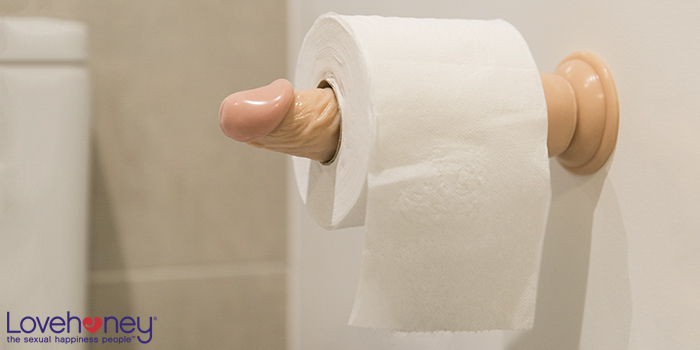 Dildo toilet roll holder