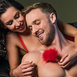 Couples playing with bondage tickler