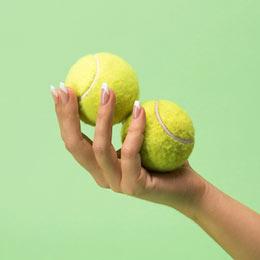 tennis-balls-hand