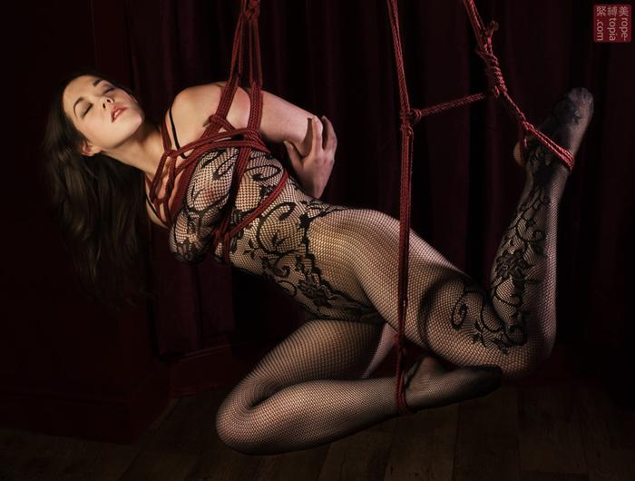 Japanese Rope Bondage Suspension (Kinkyclover.com) Rope by WykD_Dave (Rope-topia.com) Body stocking flatters this rope suspension amazingly.
